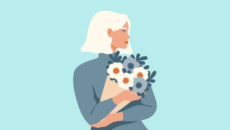 Kvinde-holder-blomster