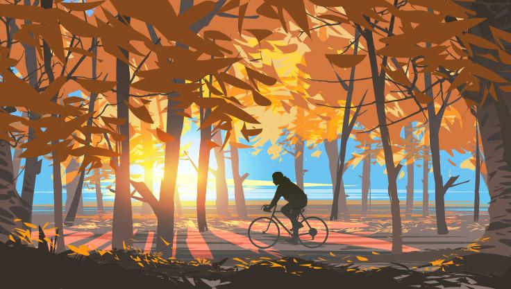 mand cykler i efteraarsnaturen